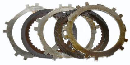 Automatic transmission clutch plates pre-cleanup.